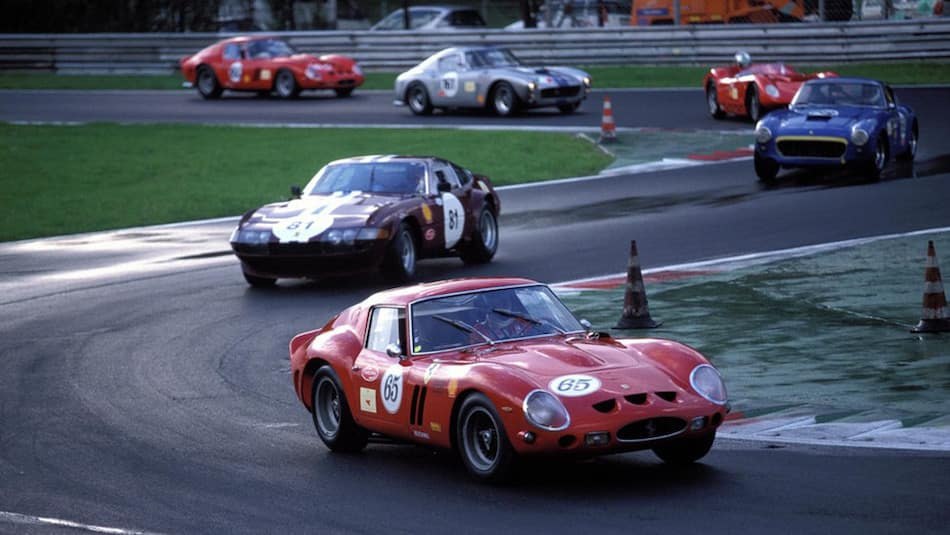 1962 Ferrari GTO Leading on a Track