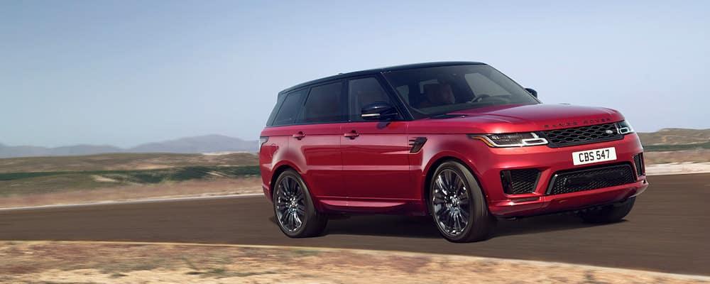 Red Range Rover Sport driving through desert