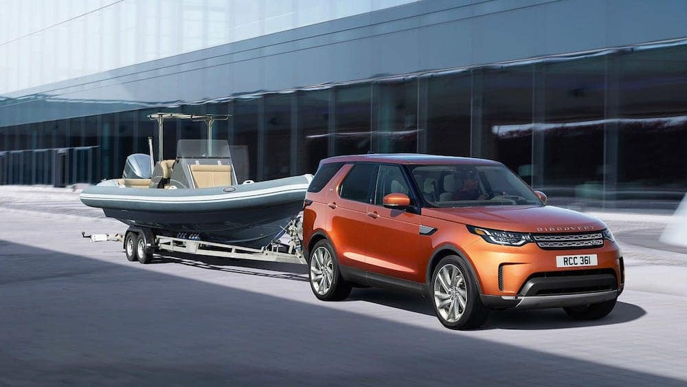 2019 Land Rover Discovery towing a small boat