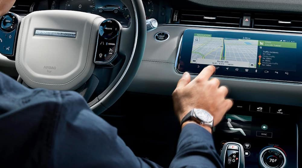 2020 Range Rover Evoque interior with touchscreen and steering wheel