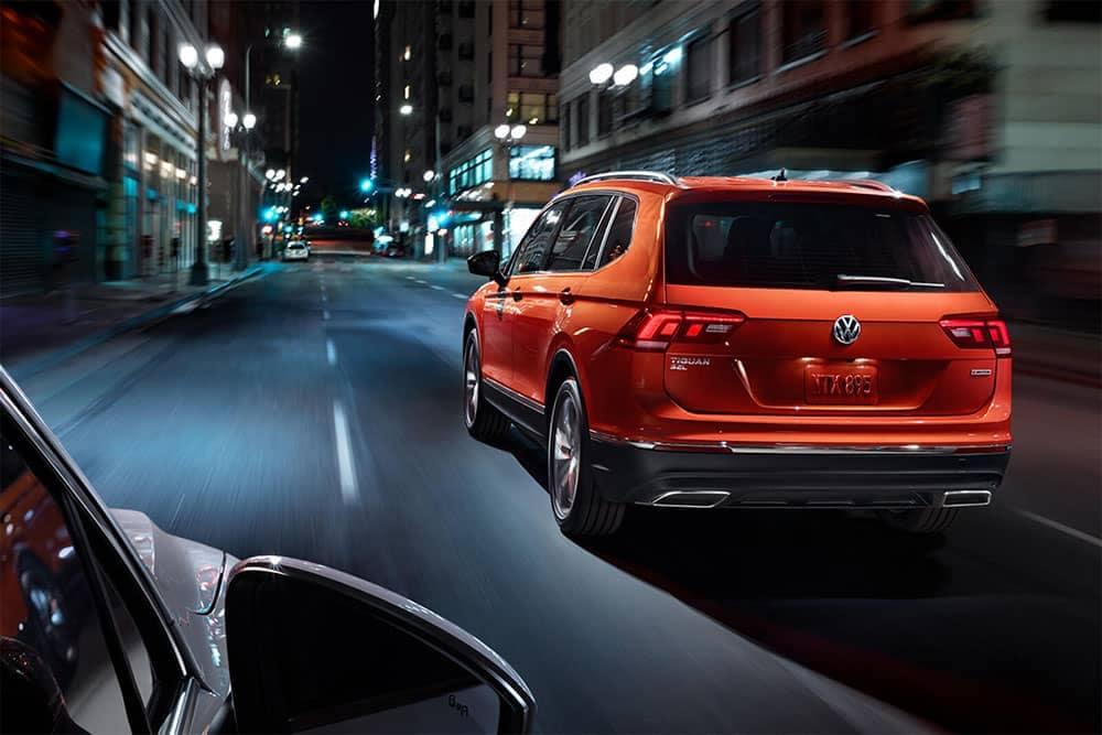2019 Volkswagen Tiguan rear view drive through city nightlife