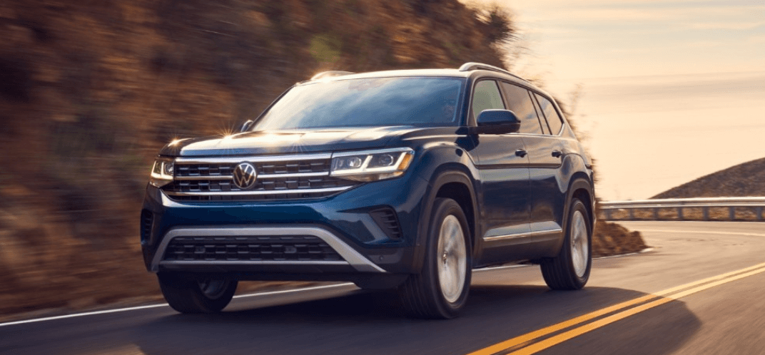 2021 Volkswagen Atlas driving on highway at sunset