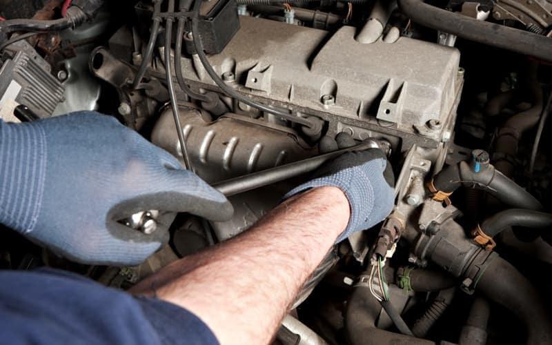 Mechanic repairs a car