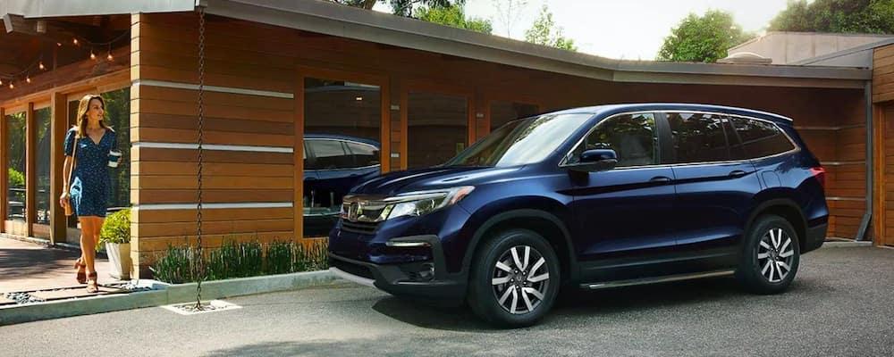 2019 Honda Pilot in blue in driveway