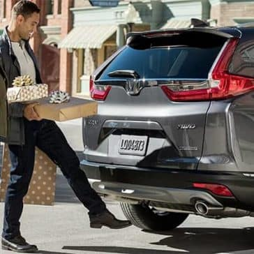 Couple Loading Presents into 2019 Honda CR-V Cargo Area