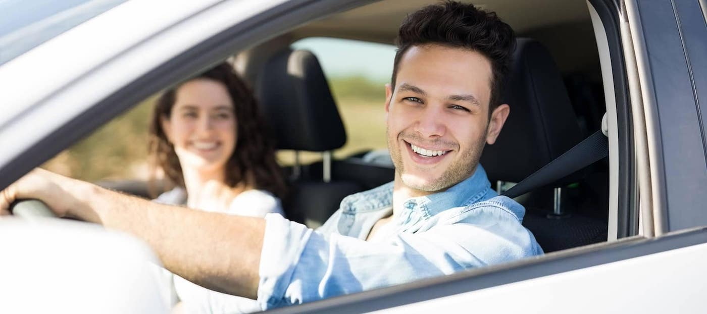 Couple Driving and Smiling