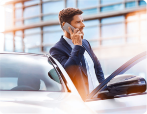 A man talking on his cell phone while getting out of his Mercedes-Benz