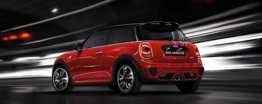 Red MINI hardtop in motion