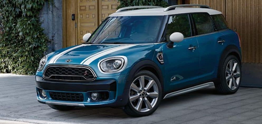 4-Door Blue MINI Parked Outside of Garage
