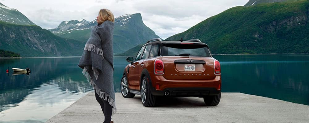 2019 MINI Cooper Countryman parked among mountain landscape banner