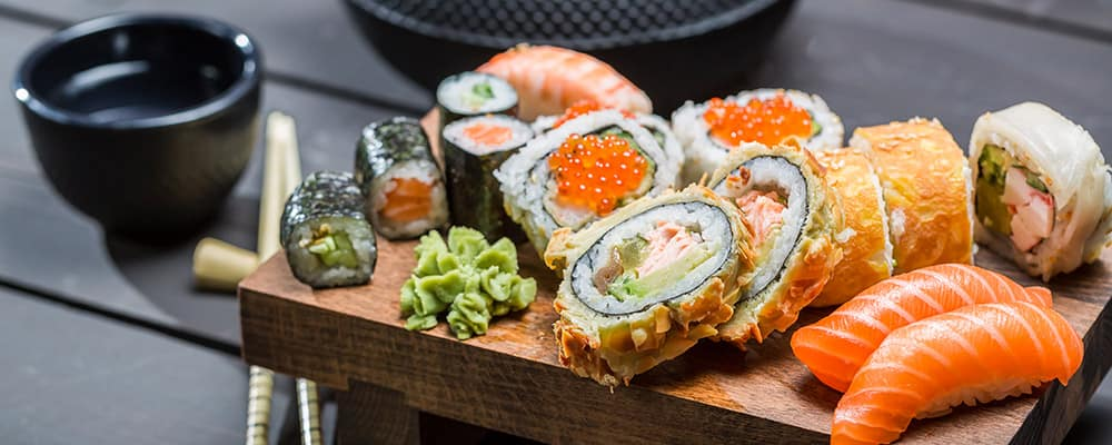 Closeup of fresh sushi on wooden board