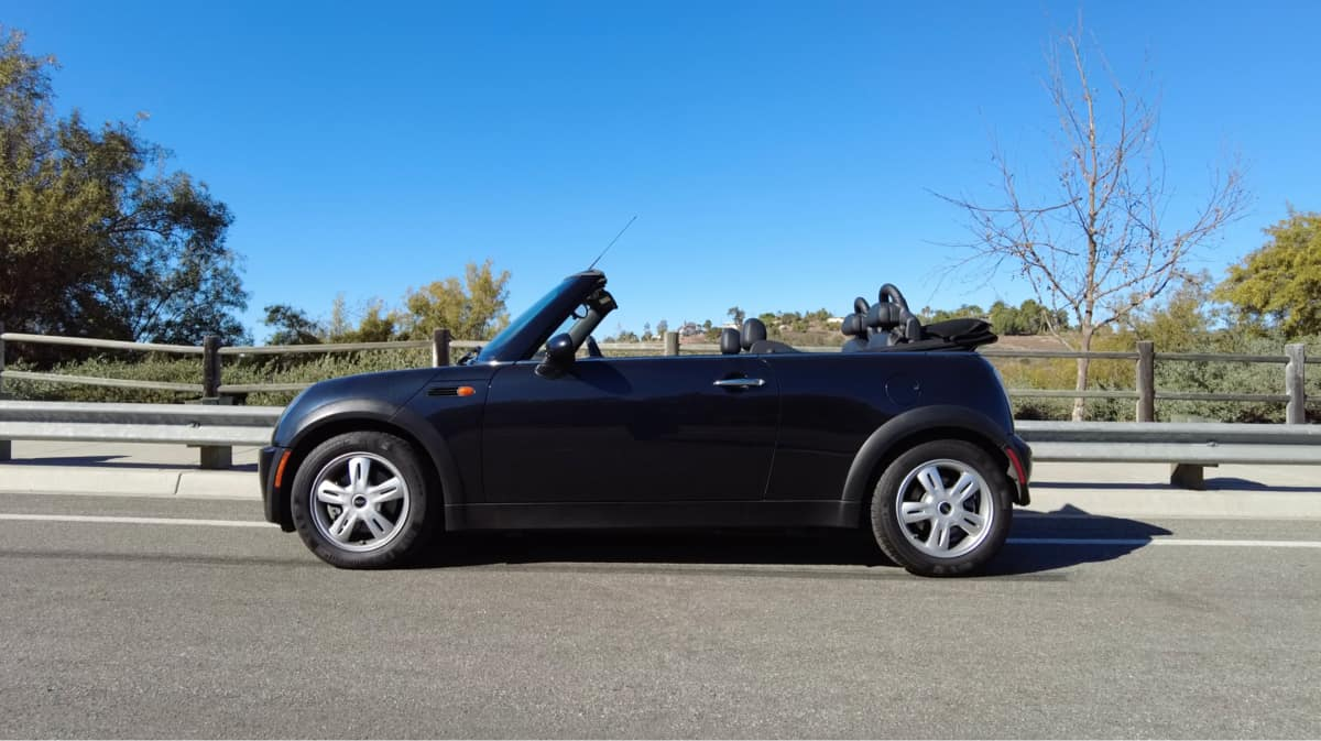 Peter Brecht's 2008 MINI Hardtop Convertible parked outside of a park.