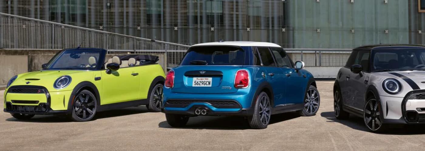 Three 2022 MINI refresh models parked next to each other