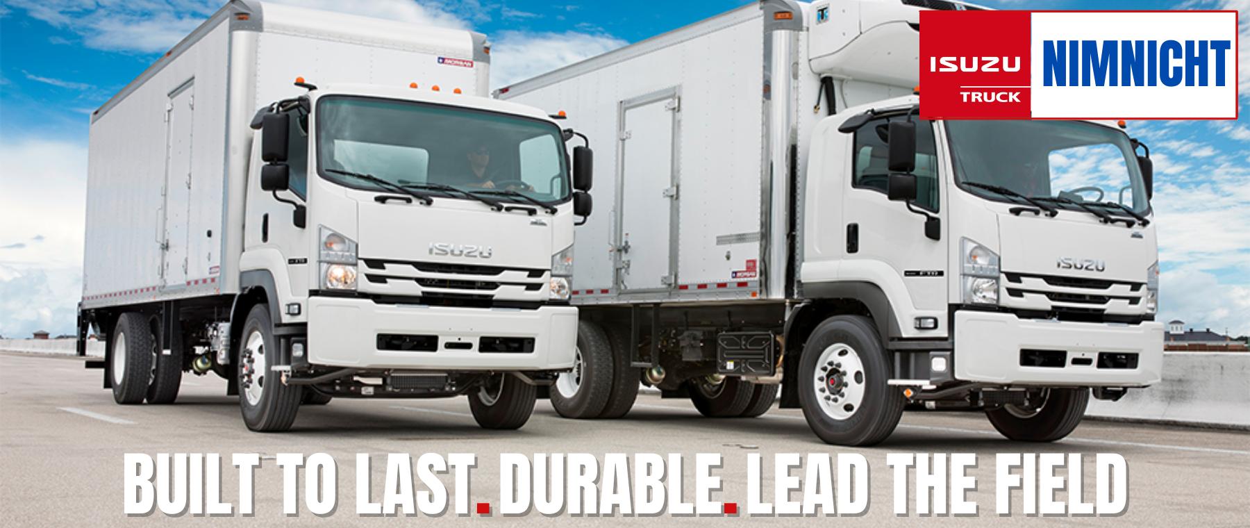 large white commercial Isuzu trucks