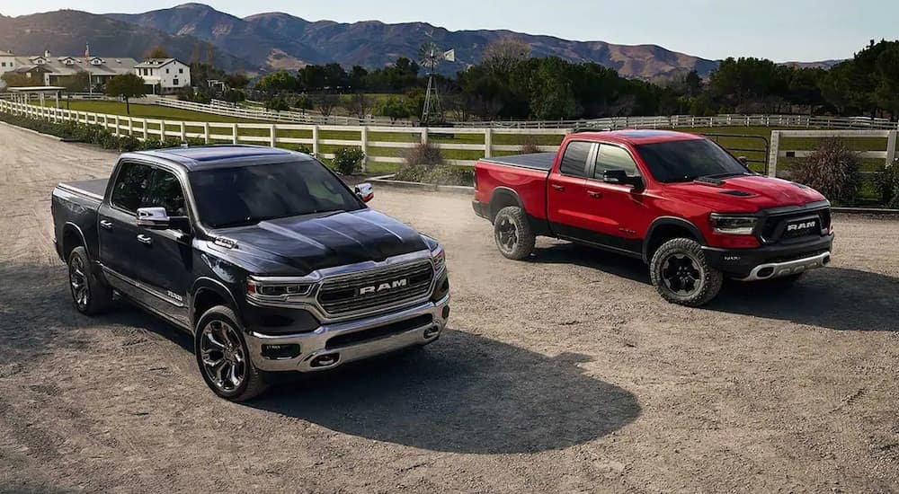 Black and red 2019 Ram 1500 Trucks parked outside a ranch