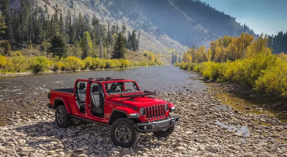 A new 2020 Jeep Gladiator crosses a large river
