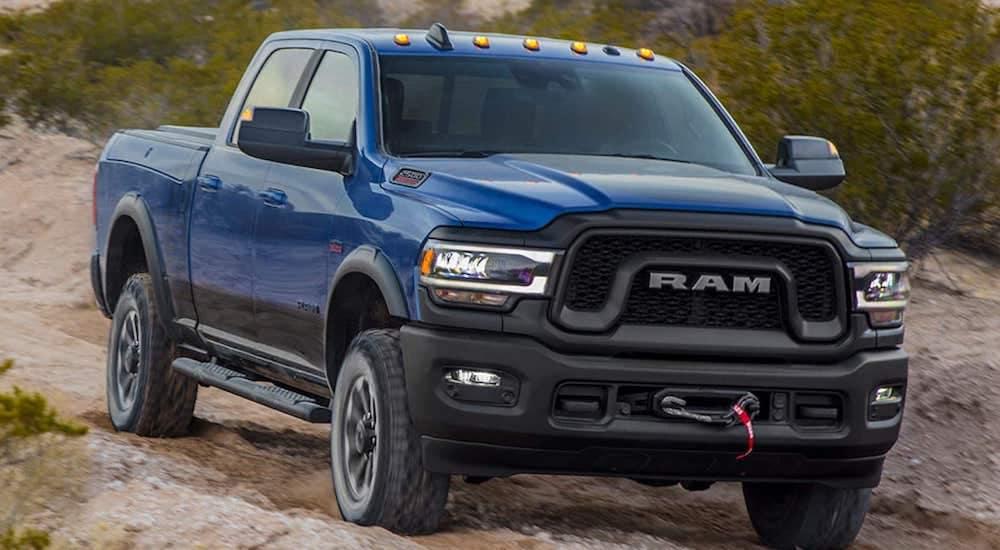 A blue 2019 Ram 2500 powers through a dirt trail