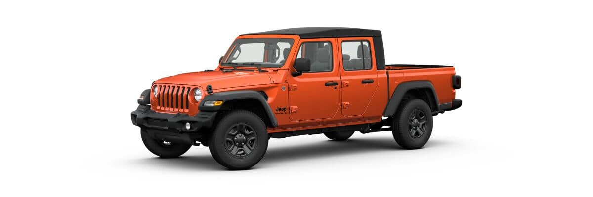 An orange 2020 Jeep Gladiator Sport with soft top facing left