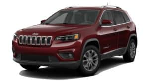 A burgundy 2020 Jeep Cherokee is facing left.