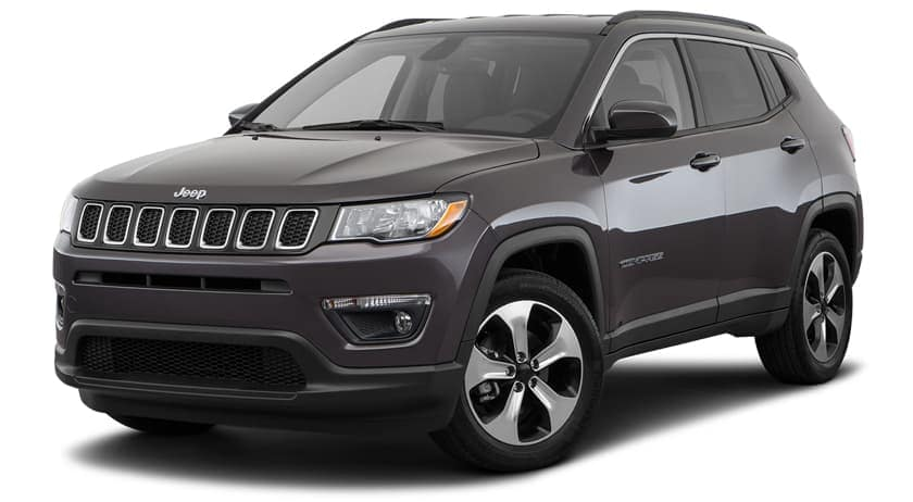 A grey 2020 Jeep Compass is facing left.