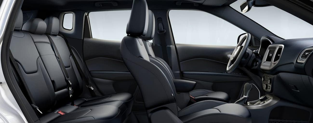 A side view of the black leather interior of a 2020 Jeep Compass is shown.