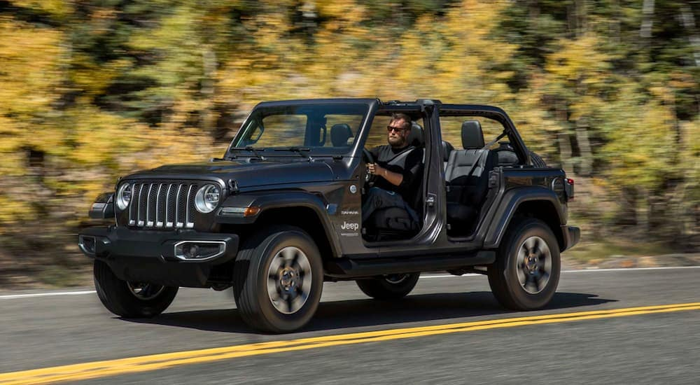 A grey 2020 Jeep Wrangler 4-door is shown from the side with no doors or top on.