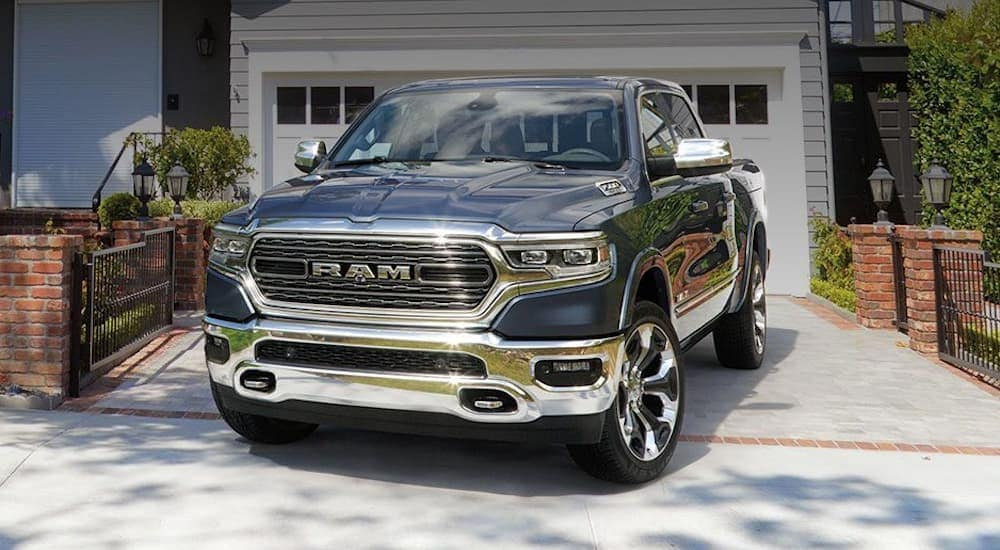 A grey 2020 Ram 1500 with chrome accents is parked in front of a Costa Mesa, CA home.