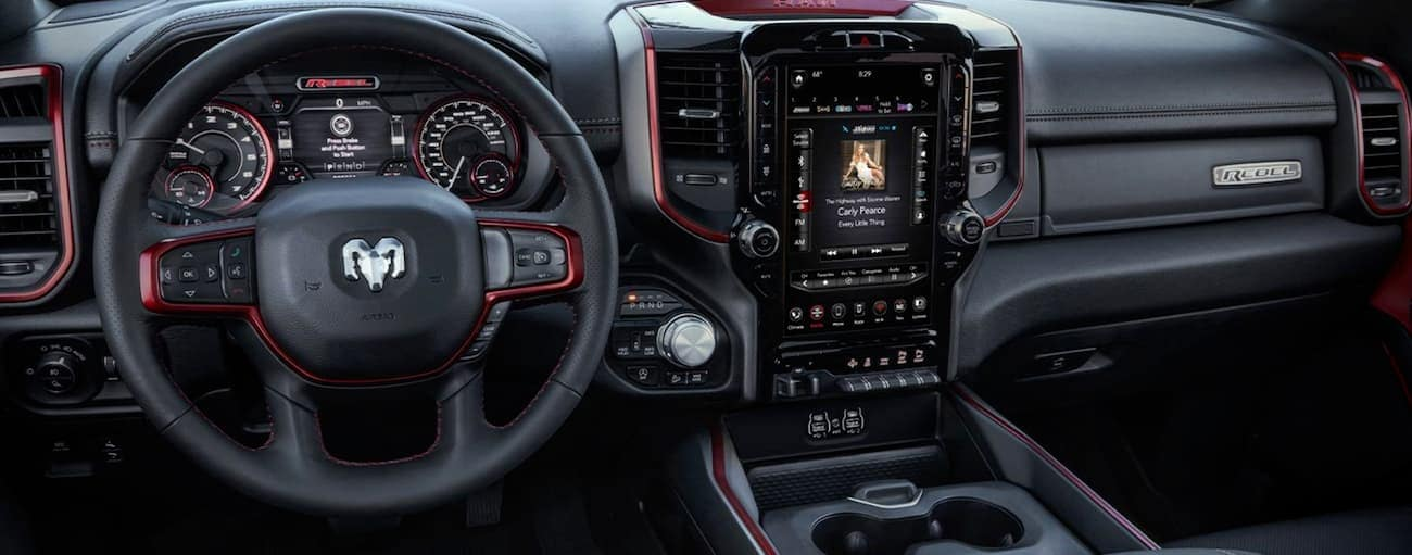 The black interior with red accents is shown from the 2020 Ram 1500.