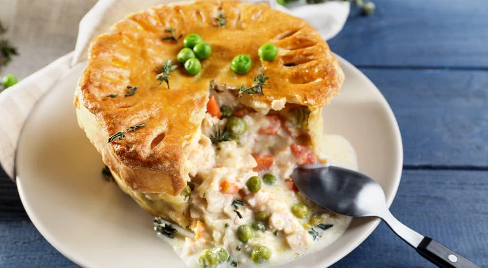 A plate of homemade chicken pot pie is shown.