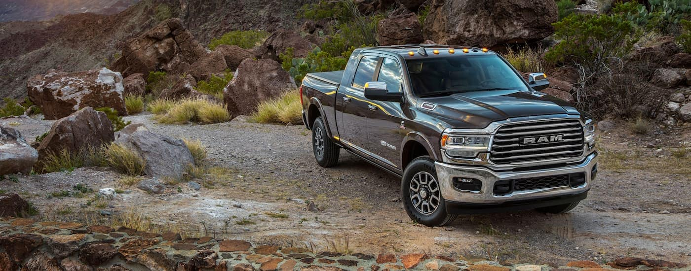 A dark grey 2020 Ram 2500, popular among Ram trucks, is parked on a dirt pull-off.