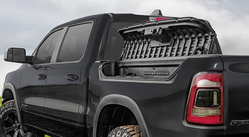 The Rambox Cargo Management System is shown on a black 2020 Ram 1500 Rebel edition's box.