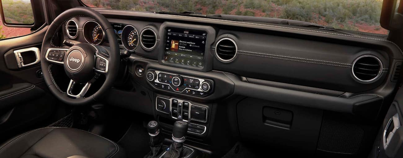 The black leather interior of a 2020 Jeep Wrangler is shown.