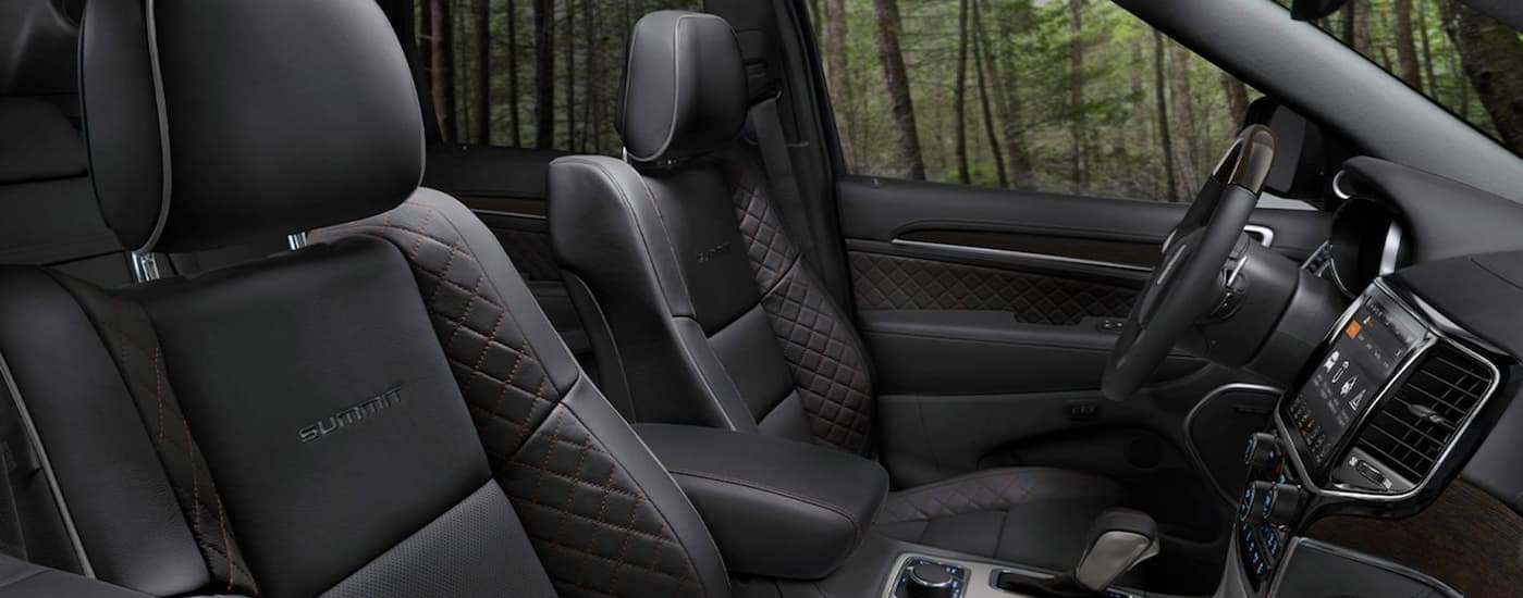 The sleek black leather interior of a 2020 Grand Cherokee Summit is shown.