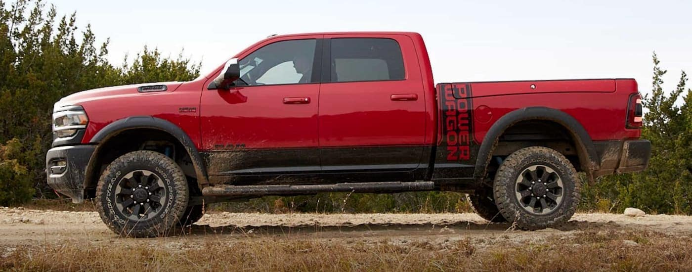 A red 2020 Ram 2500 Power Wagon is driving off-road after leaving a Ram dealership in Orange County.