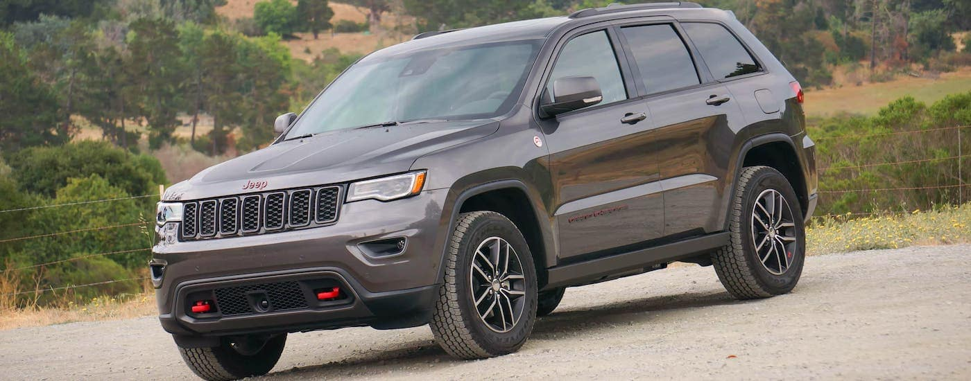 A gray 2017 Jeep Grand Cherokee Trailhawk is parked in a lot outside Costa Mesa, CA.