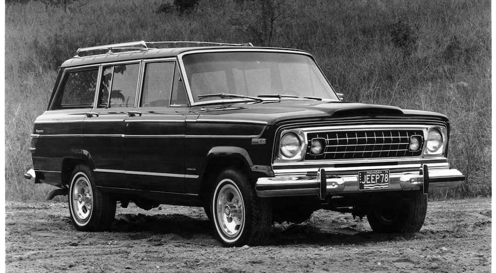 A black and white photo is shown of a classic Jeep for sale, the 1978 Wagoneer.