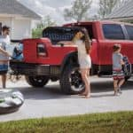 A family is loading the Rambox on their red 2020 Ram 1500, outside Costa Mesa, CA.
