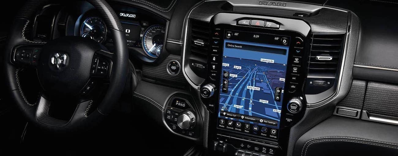 A closeup is shown of the 12-in Uconnect screen, available in a 2020 Ram 1500, winner of the screen war between 2020 Ram 1500 (new Ram) vs 2020 Ford F-150.