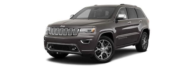 A dark grey 2020 Jeep Grand Cherokee is angled left.