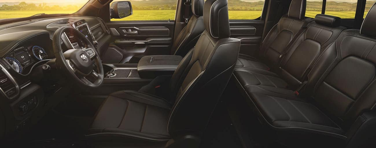 The black interior of a 2020 Ram 1500 is shown from the side.
