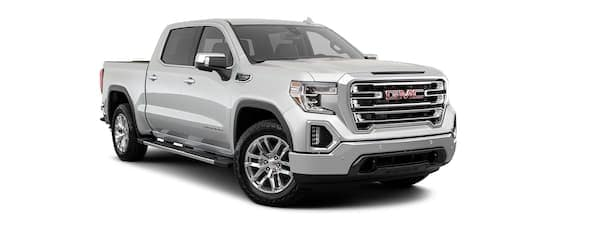 A silver 2020 GMC Sierra 1500 is facing right.