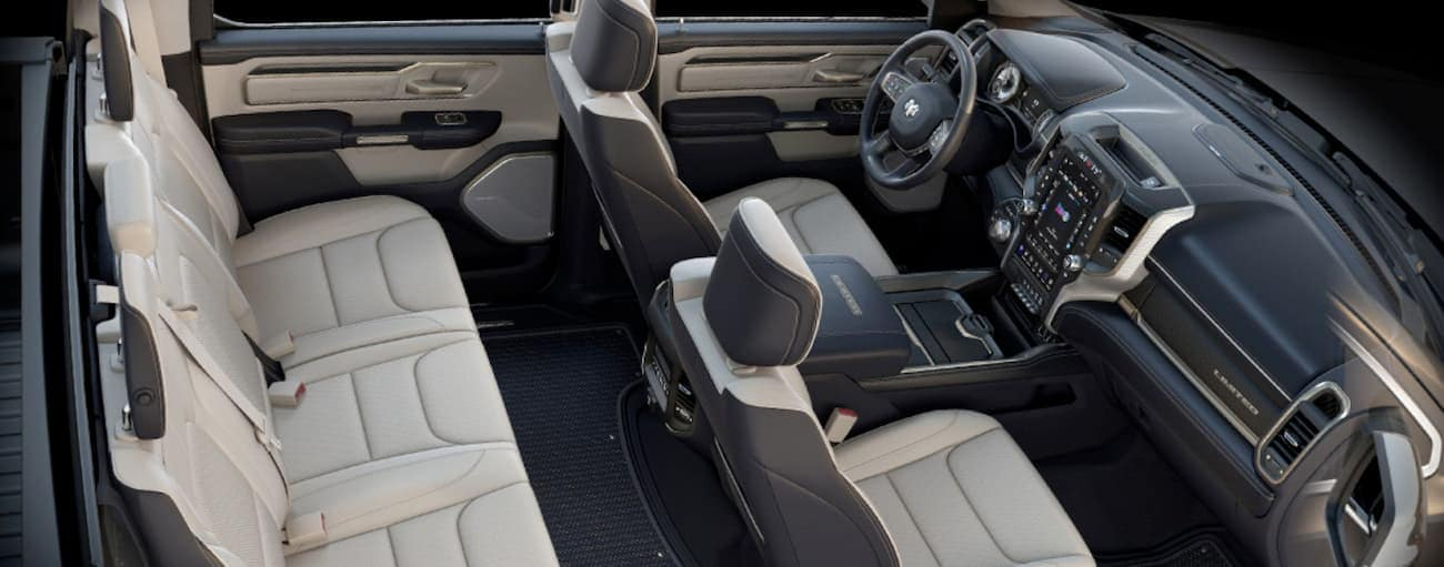 The white and black interior of a 2020 Ram 1500 is shown from above.