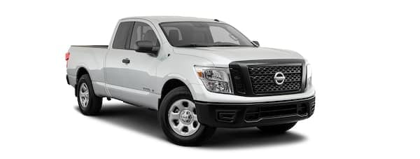 A silver 2020 Nissan Titan is facing right.