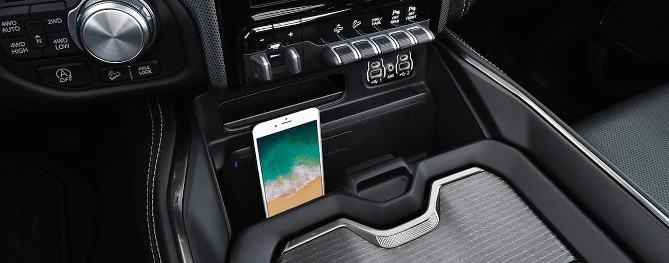 The phone charging pad in the console of a 2020 Ram 1500 is shown.