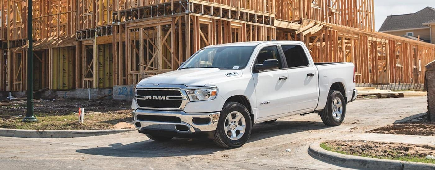 A white 2020 Ram 1500 is leaving a construction site near Costa Mesa, CA.
