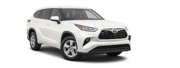 A white 2020 Toyota Highlander is angled right.