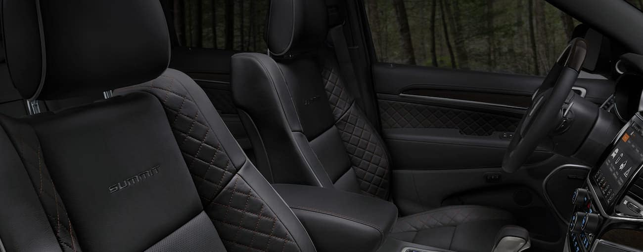 The black interior of a 2020 Jeep Grand Cherokee is shown.