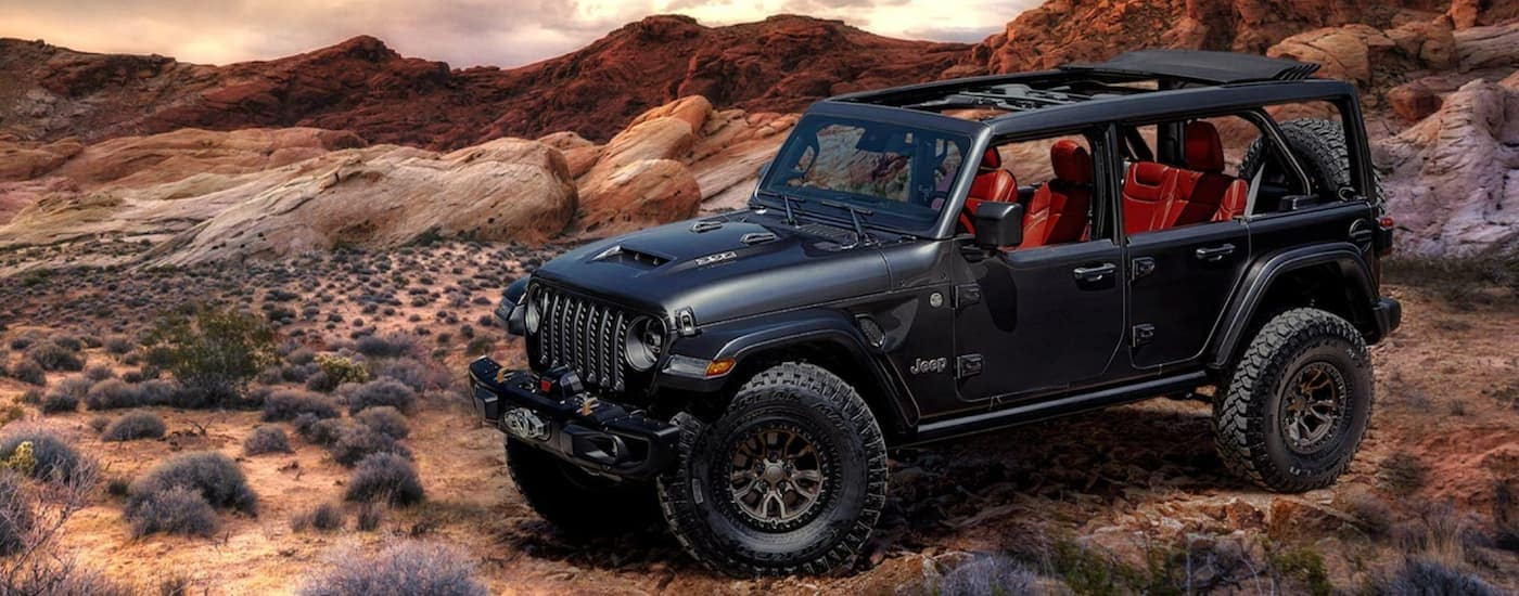A black 2020 Jeep Wrangler Unlimited is parked in the desert.