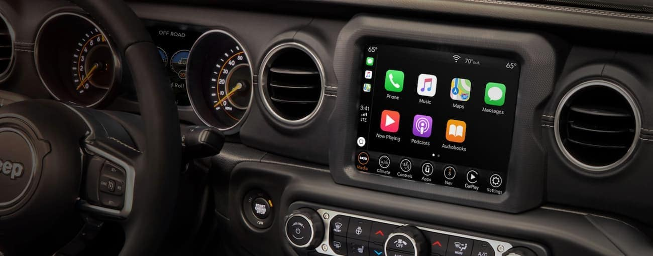 The infotainment screen in a 2020 Jeep Wrangler Unlimited is shown.