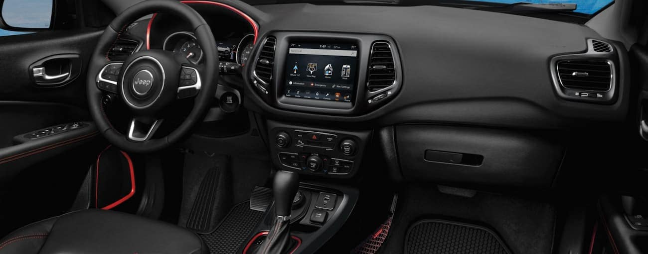 The black interior with red detail in a 2020 Jeep Compass is shown.